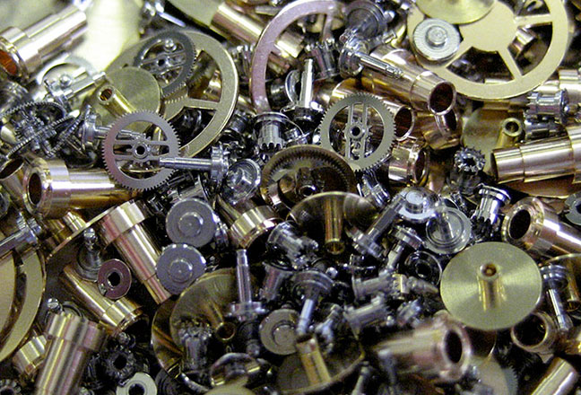 Watchmaking: Spindle, pinions, wheels and escapements